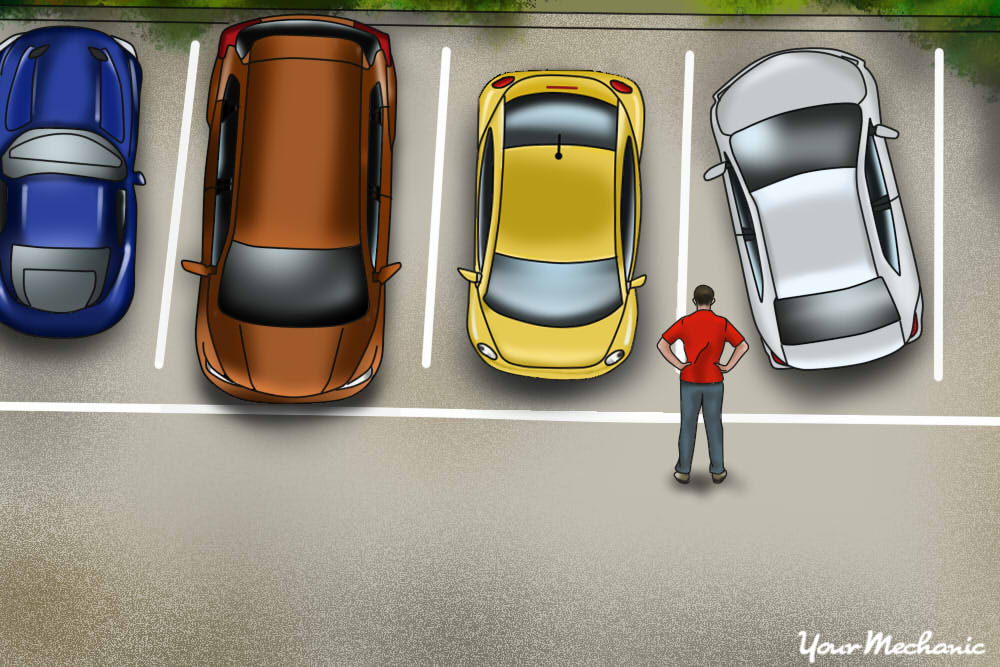 person checking the space in between cars