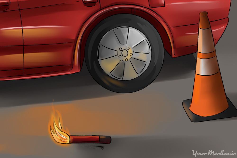 road flares and traffic cones near parked car