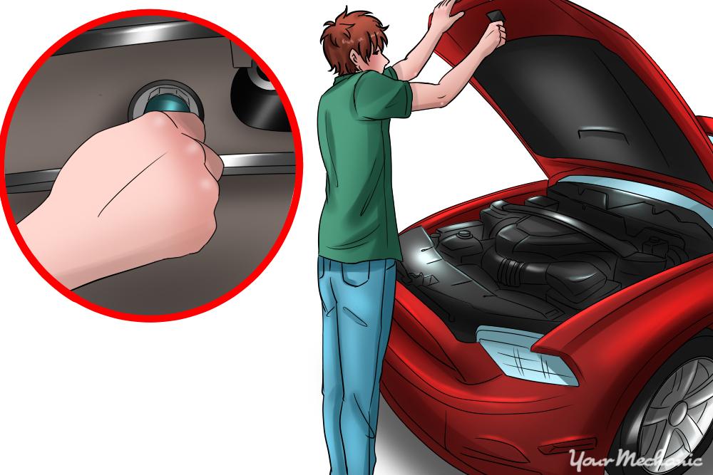 person adjusting bolt underhood
