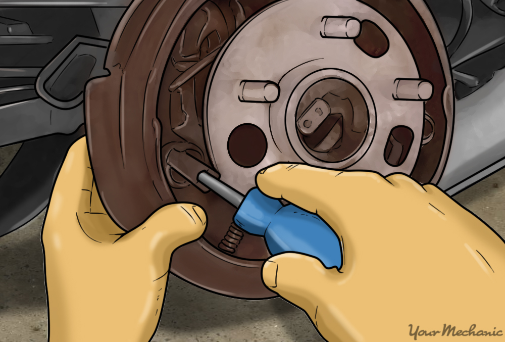 removing the hold-down springs with a dedicated tool