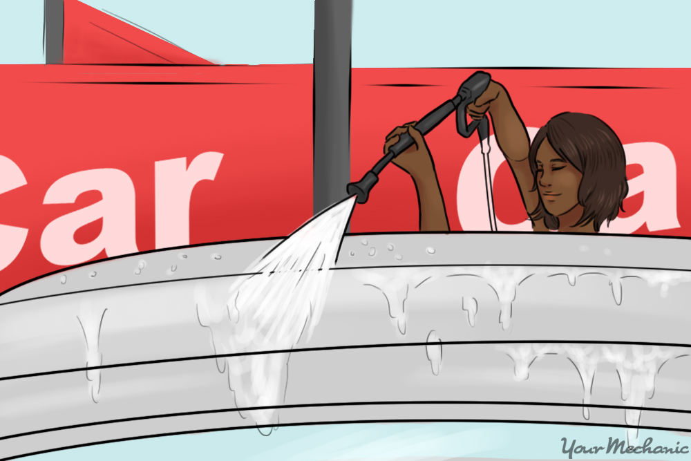 rinsing car with sprayer