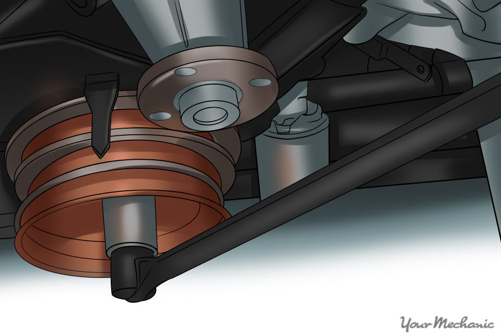 ratchet and socket being used to turn a crankshaft pulley