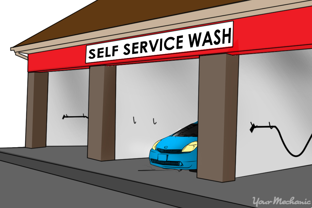 car pulling out of a self serve wash bay