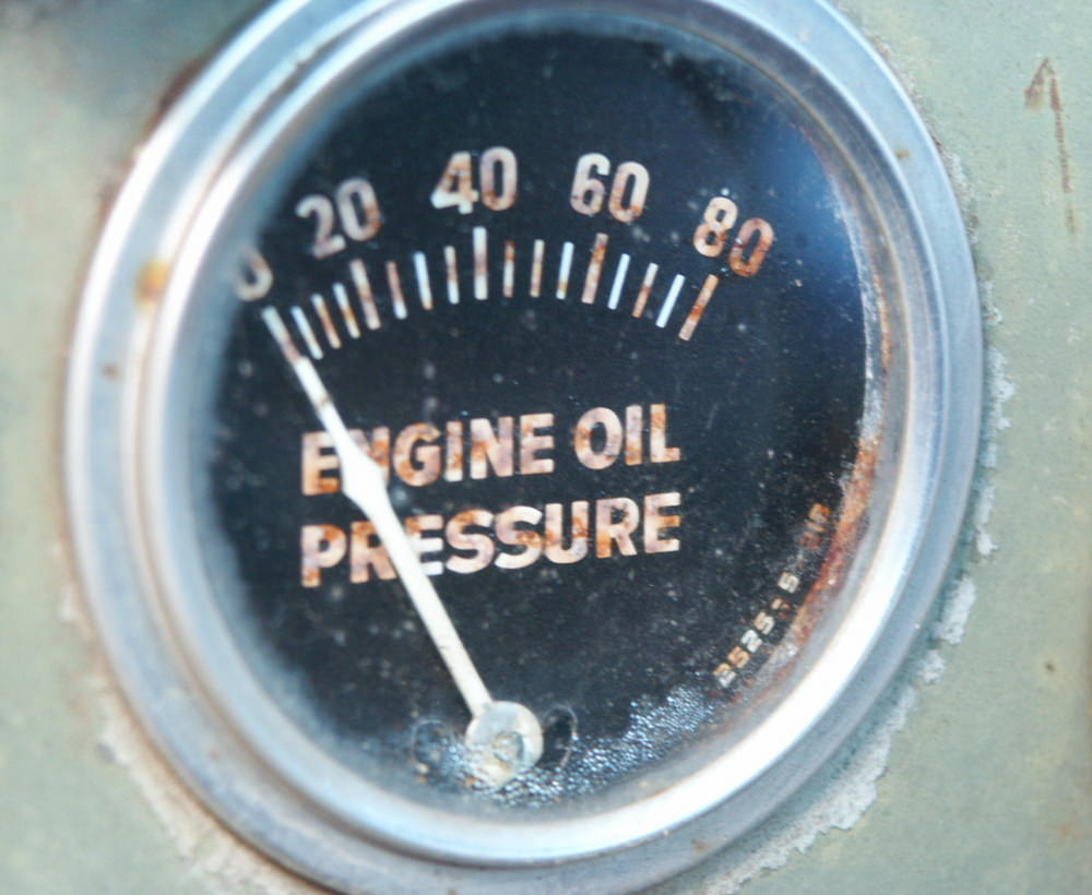 What should I do if the oil pressure lamp is on