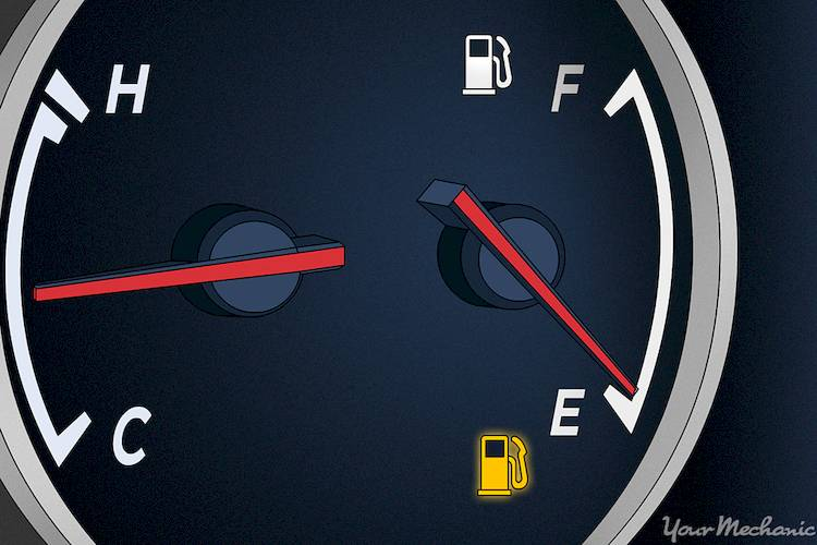 fuel gage with low fuel light illuminated