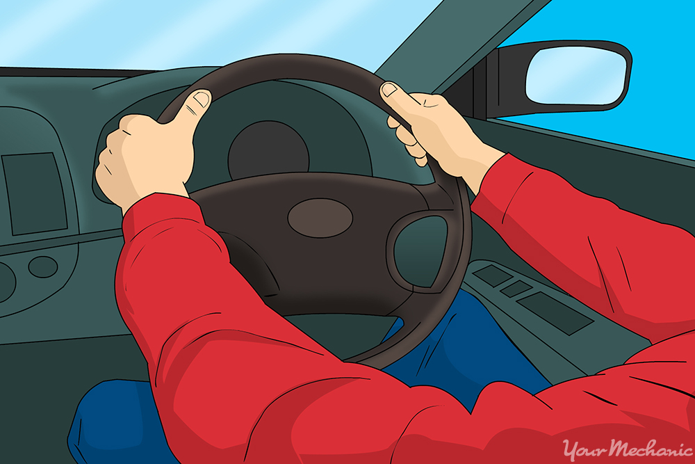 person holding onto steering wheel