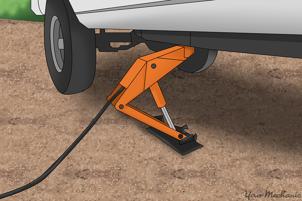 floor jack raising vehicle off the ground