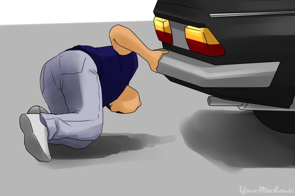 inspecting underneath a car