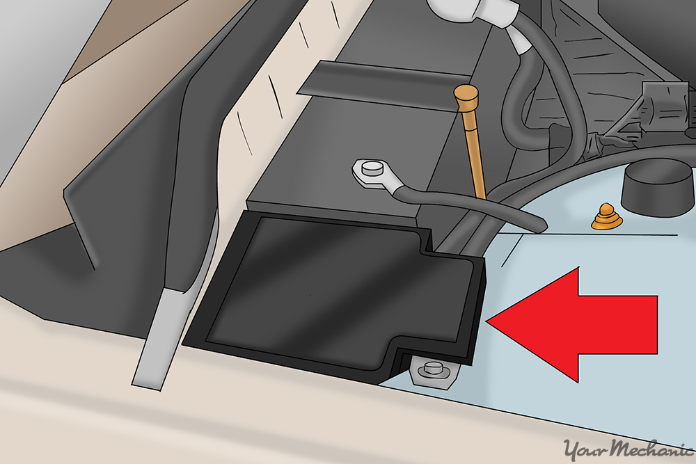 fuse box in the engine compartment with an arrow pointing to it