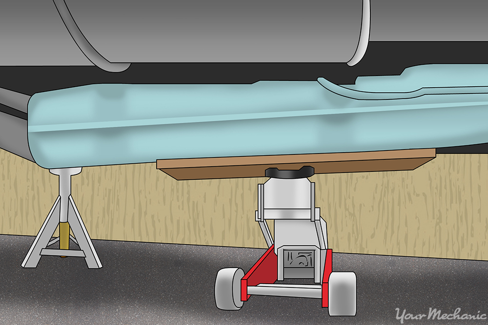 transmission jack being used on a fuel tank