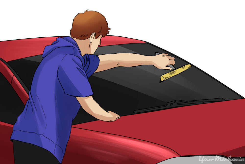 How to Fix Squeaky Windshield Wiper Blades - person cleaning windshield