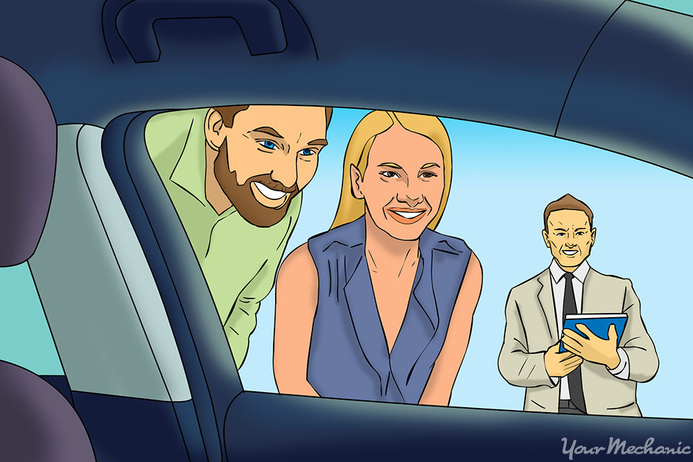 couple smiling looking into the drivers side window of a car