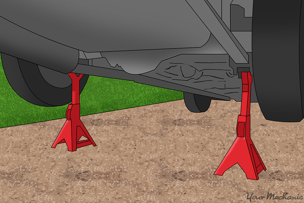 jack stands secured under car