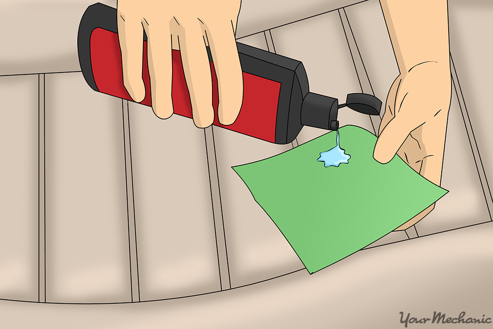 how to clean stains off vinyl purse