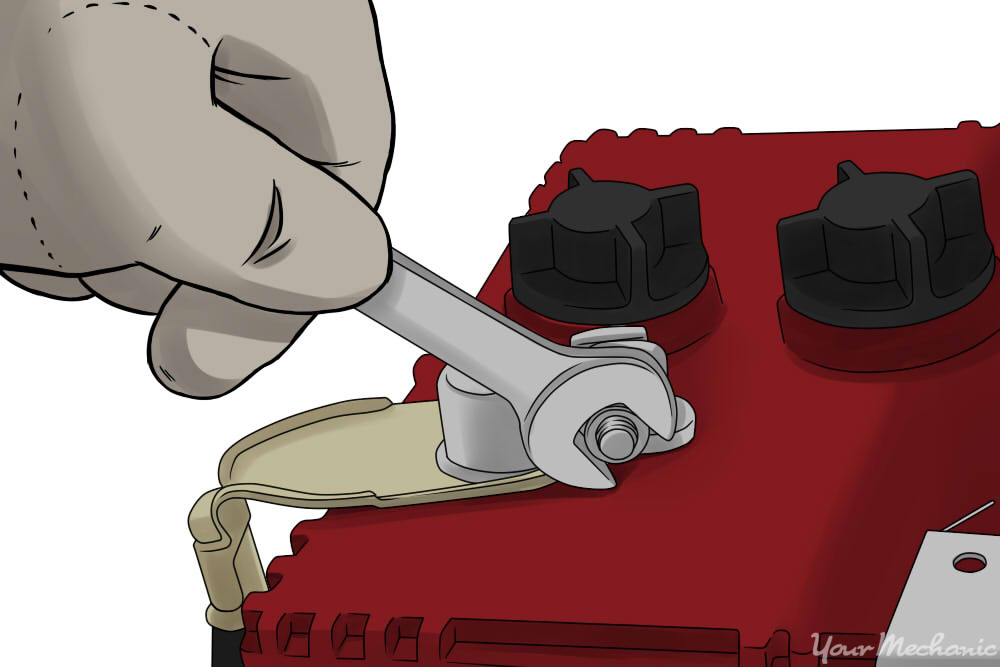 loosening a battery nut with a wrench