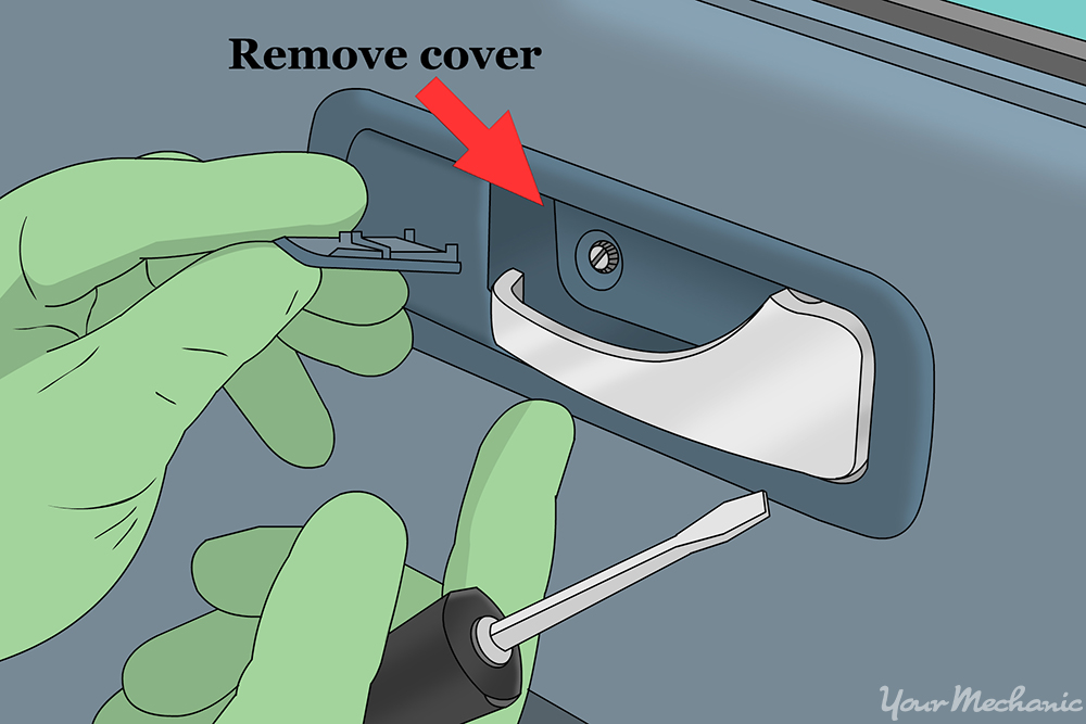 hand removing the plastic cover from behind the door handle