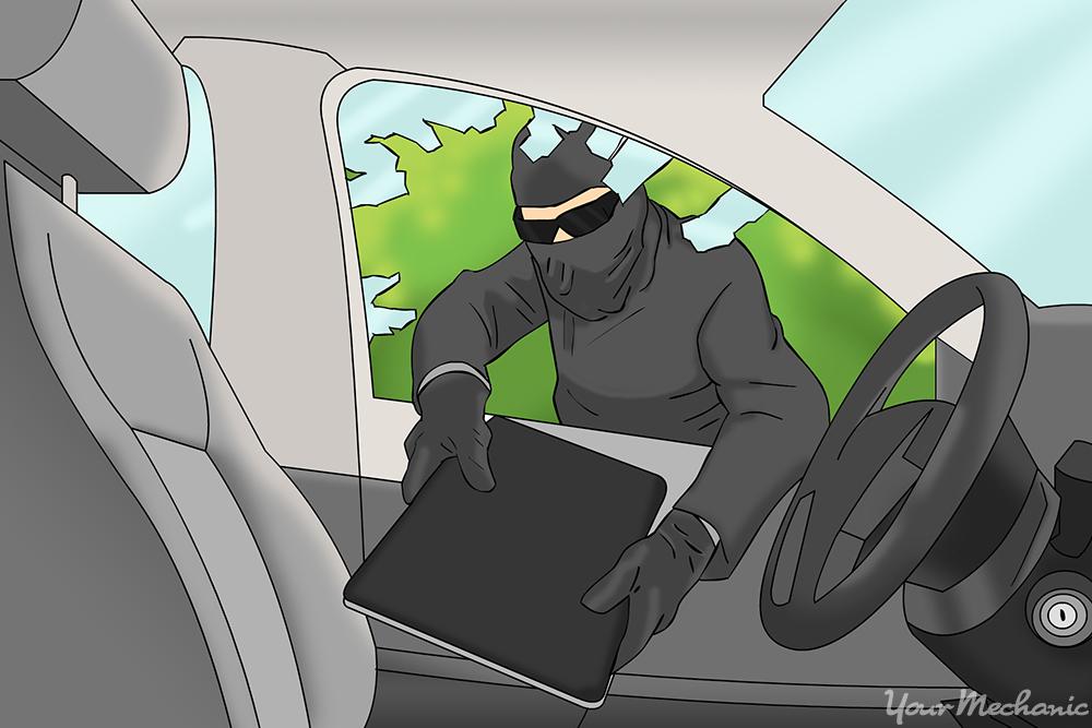 burglar taking laptop from car through smashed window