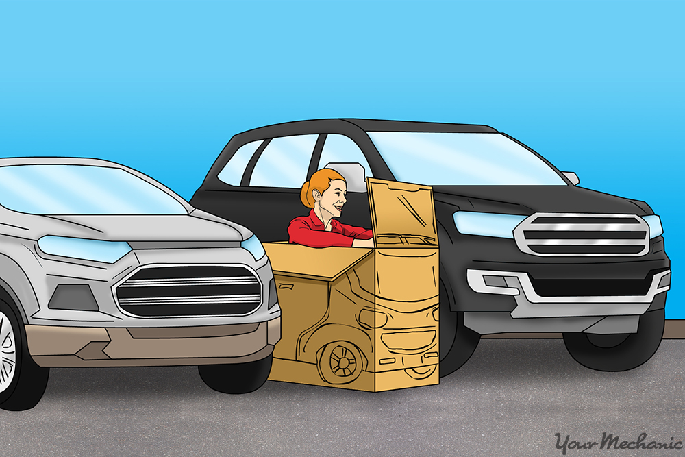 woman in box between two cars