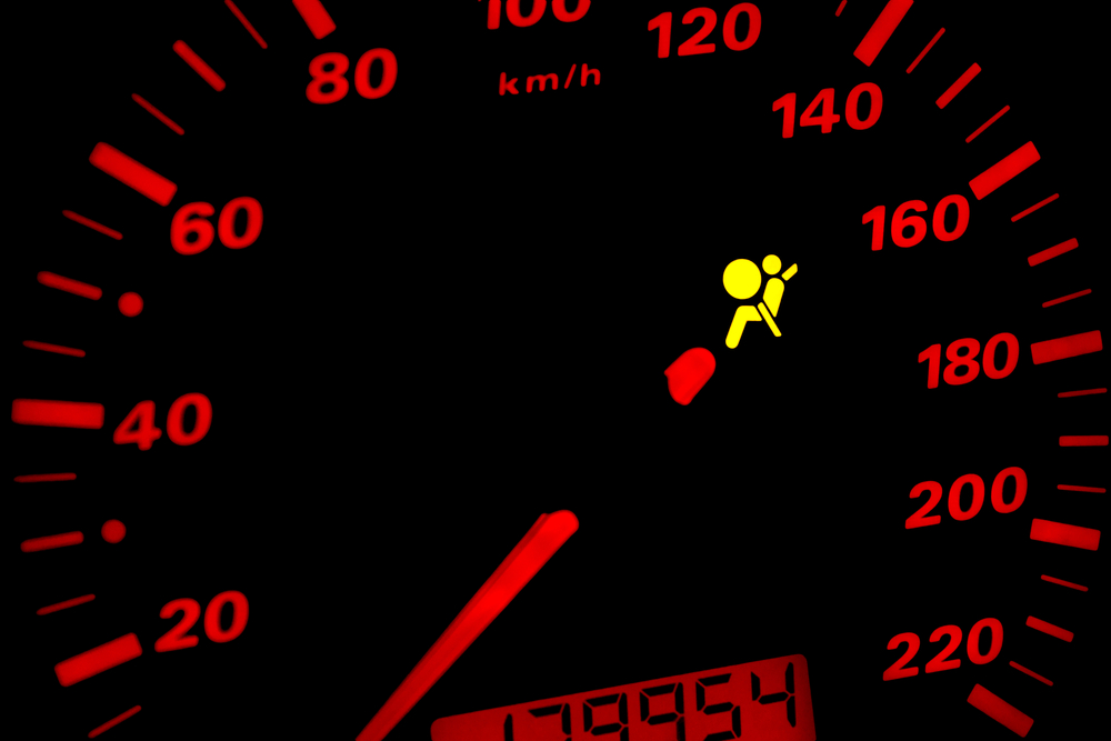 Resultado de imagem para a seatbelt light on the dashboard.