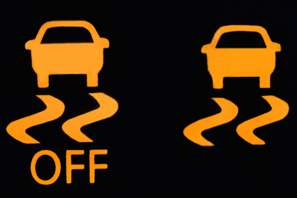 Is It Safe To Drive With The Traction Control TCS Light On - Car sign on dashboard