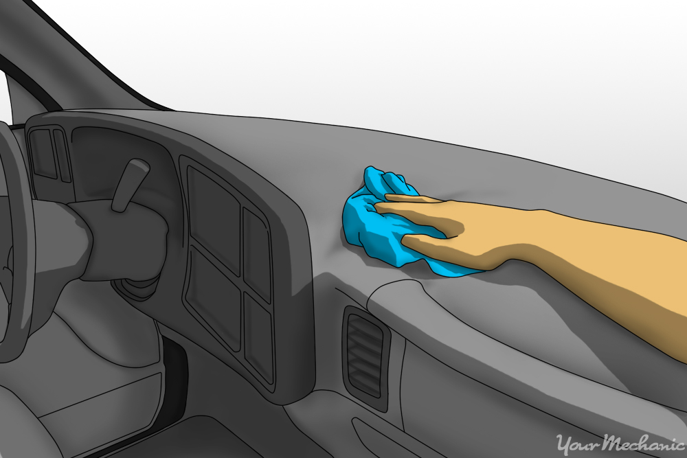 person cleaning top of dash