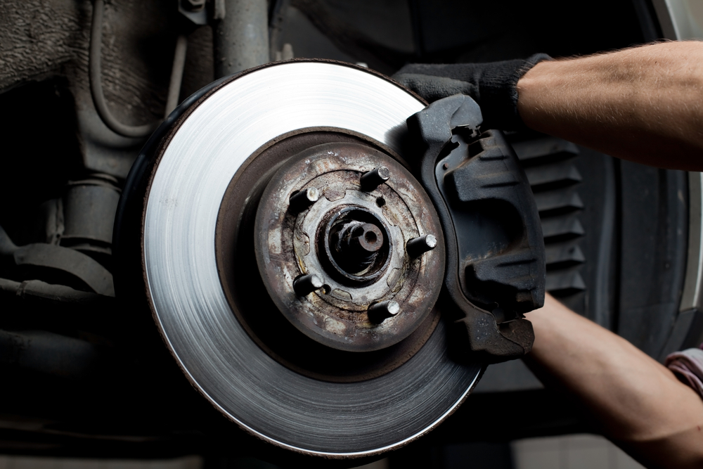 mechanic adjusting a car brake