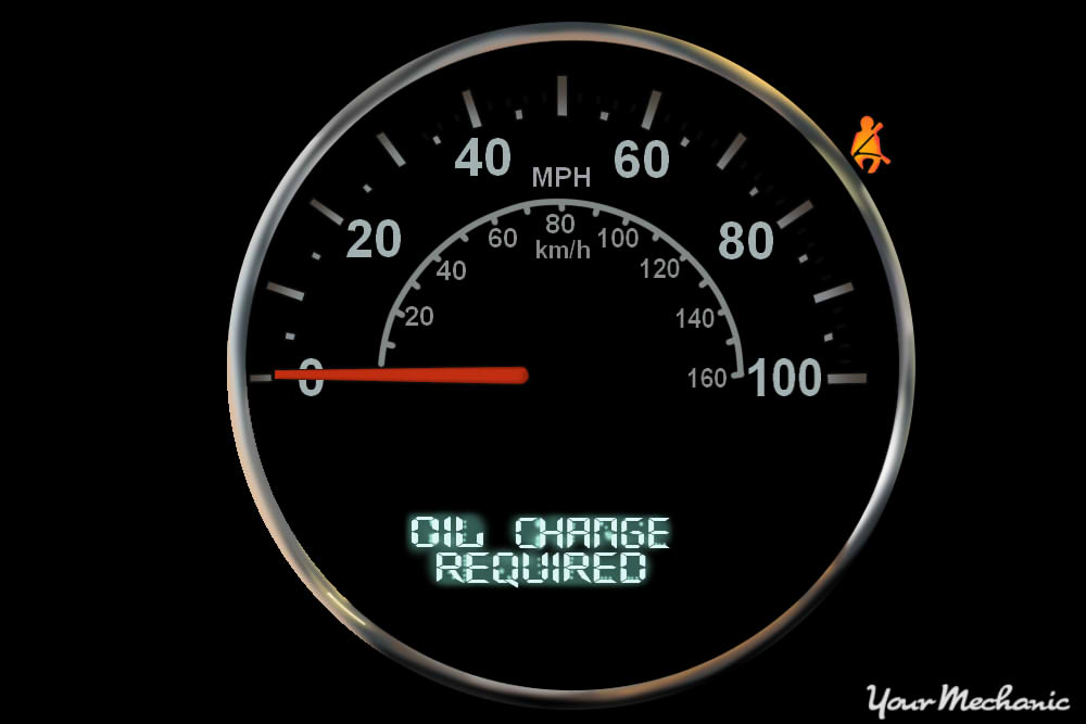 Understanding Jeep Service Indicator Lights - view of Jeep instrument display with Oil Change Required message on